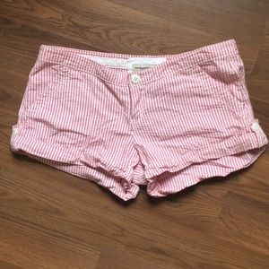 A pair of red and pink striped seersucker shorts